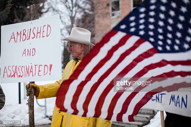 Rancher Monte Siegner holds a sign during a protest against government actions in Burns Oregon on January 29 a day after the FBI released video...