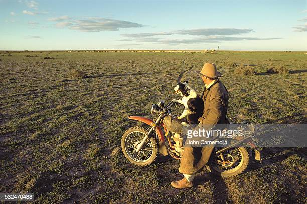 Rancher with Sheepdog on a Motorcycle