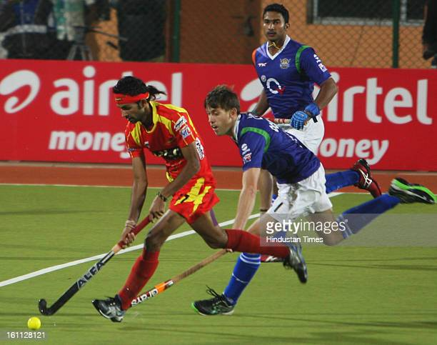 Ranchi Rhinos and Uttar Pradesh Wizard team sin action during the Hockey India League semi final match at Astro turf stadium on February 9 2013 in...