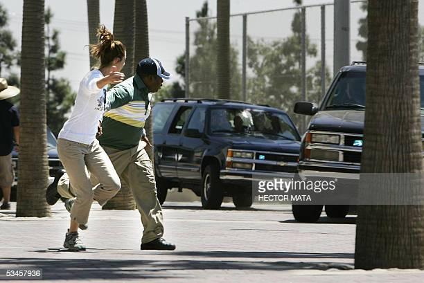 FOR USE WITH AFP STORY AFPLIFESTYLEUSSTUNTMEN Stacy Carino and Larnell Stovall members of 'Stunts Unlimited' run infront a car during the shooting of...