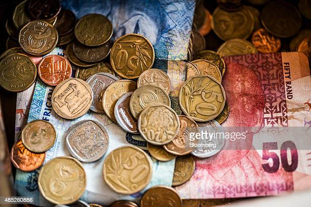 Rand coins and banknotes sit in a cash box in Johannesburg South Africa on Wednesday Aug 26 2015 More than four years of currency declines to a fresh...