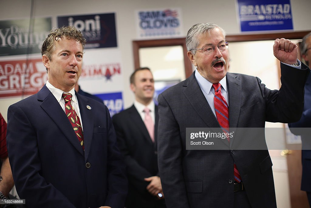 U.S. Rand Paul (R-KY) and Iowa Gov. Terry Branstad (R) listen to speakers at an event hosted by the Iowa GOP Des Moines Victory Office on August 6, 2014 in Urbandale, Iowa. Paul, who is expected to seek the 2016 Republican presidential nomination, was on a three-day, eight-city tour of Iowa, the first state in the nation to select the presidential nominee.