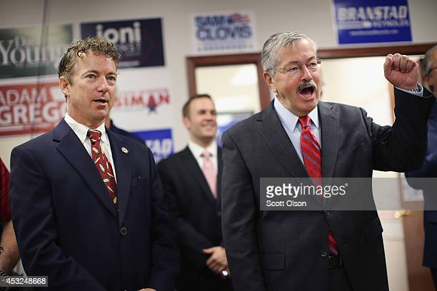 S Rand Paul and Iowa Gov Terry Branstad listen to speakers at an event hosted by the Iowa GOP Des Moines Victory Office on August 6 2014 in Urbandale...