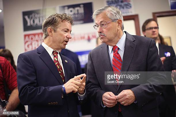 S Rand Paul chats with Iowa Gov Terry Branstad during an event hosted by the Iowa GOP Des Moines Victory Office on August 6 2014 in Urbandale Iowa...