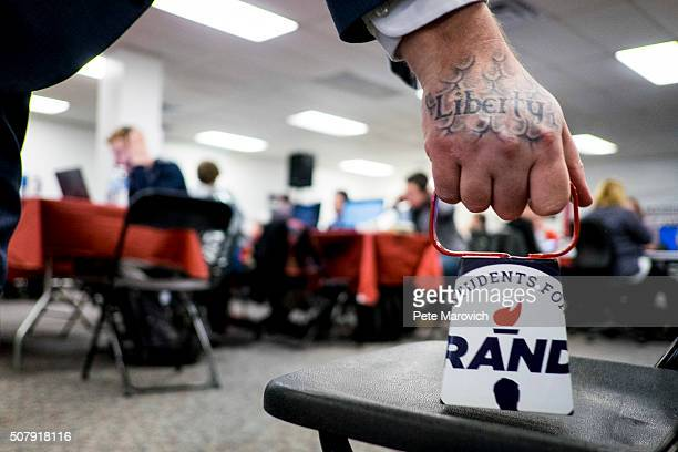 Rand Paul volunteer rings a cowbell to signify another committed voter for Presidential Candidate Rand Paul at Paul's Des Moines headquarters on...