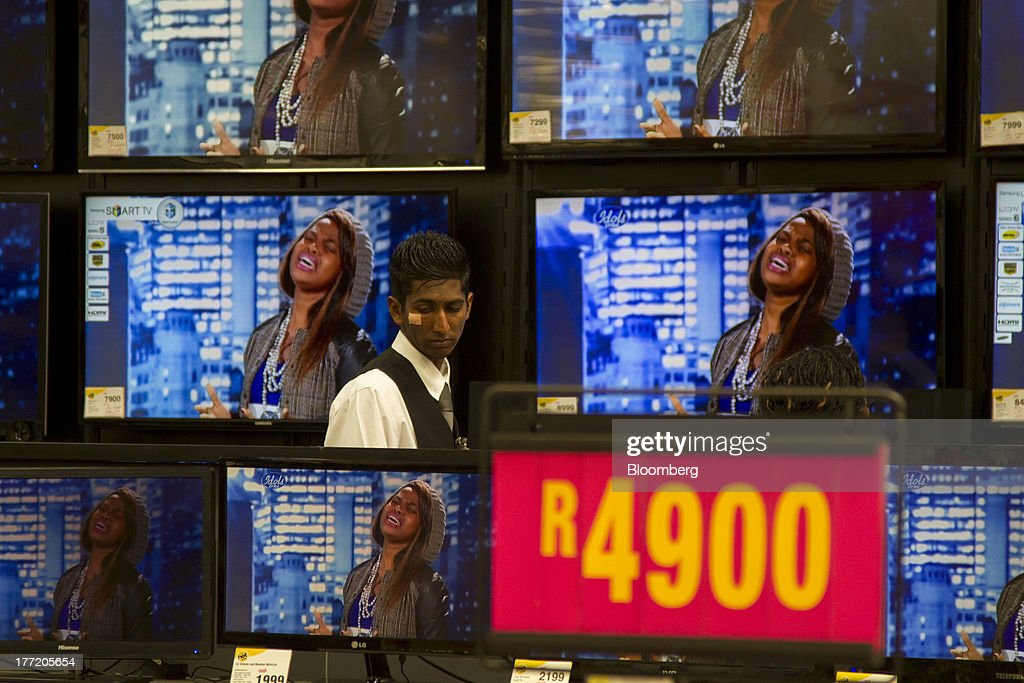 A rand price sign stands beside television screens for sale inside a Game supermarket, part of Massmart Holdings Ltd, in the Fourways district of Johannesburg, South Africa, on Thursday, Aug. 22, 2013. Massmart Holdings Ltd., the South African food and goods wholesaler owned by Wal-Mart Stores Inc., said revenue growth continued to slow in August after a downturn in consumer spending hurt first-half earnings. Photographer: Nadine Hutton/Bloomberg via Getty Images