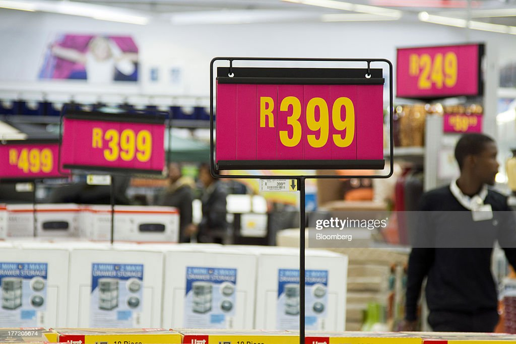 Rand price signs stand on display above goods for sale inside a Game supermarket, part of Massmart Holdings Ltd, in the Fourways district of Johannesburg, South Africa, on Thursday, Aug. 22, 2013. Massmart Holdings Ltd., the South African food and goods wholesaler owned by Wal-Mart Stores Inc., said revenue growth continued to slow in August after a downturn in consumer spending hurt first-half earnings. Photographer: Nadine Hutton/Bloomberg via Getty Images