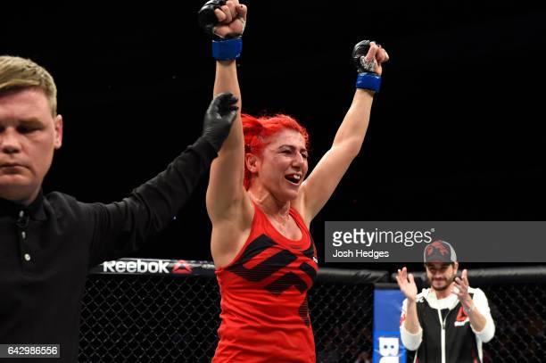 Randa Markos of Iraq celebrates after defeating Carla Esparza in their women's strawweight fight during the UFC Fight Night event inside the...