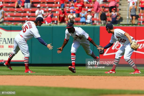 Randal Grichuk Dexter Fowler and Stephen Piscotty of the St Louis Cardinals celebrate after beating the New York Mets at Busch Stadium on July 9 2017...