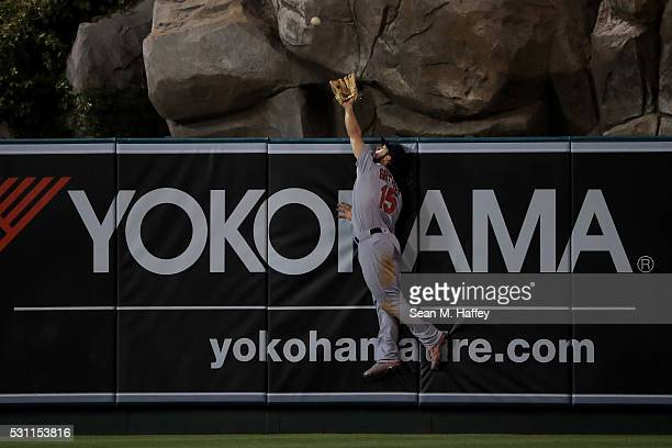 Randal Grichuk of the St Louis Cardinals can't make the catch on a Albert Pujols of the Los Angeles Angels of Anaheim homerun during the ninth inning...