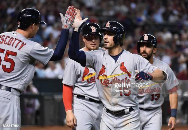 Randal Grichuk of the St Louis Cardinals celebrates with teammates Matt Carpenter Luke Voit and Stephen Piscotty after hitting a three run home run...