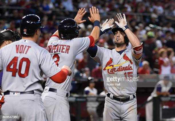 Randal Grichuk of the St Louis Cardinals celebrates with teammates Matt Carpenter and Luke Voit after hitting a three run home run off of Ruby De La...
