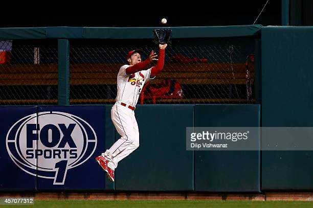Randal Grichuk of the St Louis Cardinals fields a double hit by Pablo Sandoval of the San Francisco Giants in the second inning during Game One of...