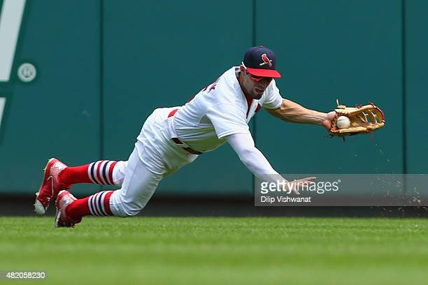 Randal Grichuk of the St Louis Cardinals fields a ground ball against the Atlanta Braves in the third inning at Busch Stadium on July 26 2015 in St...