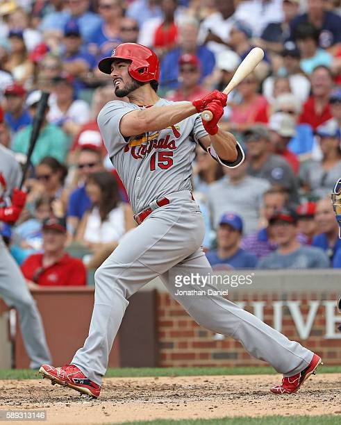 Randal Grichuk of the St Louis Cardinals follows the flight of his grand slam home run in the 8th inning against the Chicago Cubs at Wrigley Field on...