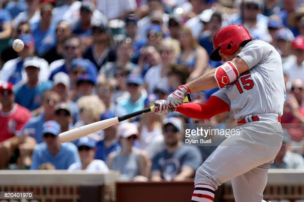 Randal Grichuk of the St Louis Cardinals hits a home run in the second inning against the Chicago Cubs at Wrigley Field on July 21 2017 in Chicago...