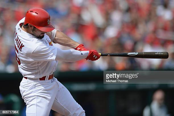 Randal Grichuk of the St Louis Cardinals hits a single in the fifth inning against the Chicago Cubs at Busch Stadium on September 14 2016 in St Louis...
