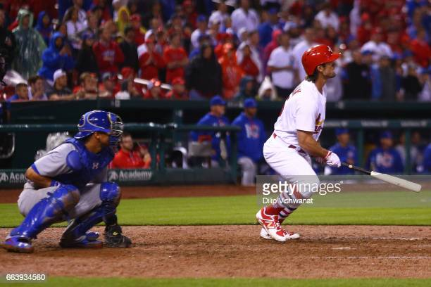 Randal Grichuk of the St Louis Cardinals hits a walkoff single against the Chicago Cubs in the ninth inning during the 2017 MLB Opening Day at Busch...