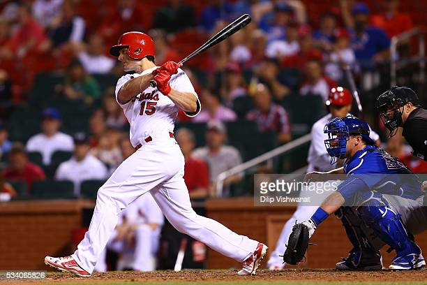 Randal Grichuk of the St Louis Cardinals hits an RBI single against the Chicago Cubs in the ninth inning at Busch Stadium on May 24 2016 in St Louis...