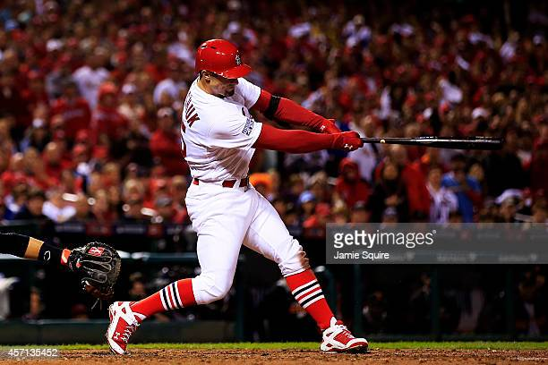 Randal Grichuk of the St Louis Cardinals hits an RBI single scoring Matt Adams in the fourth inning against the San Francisco Giants during Game Two...
