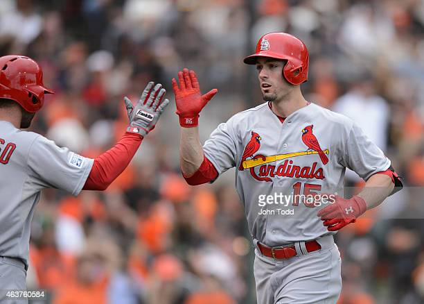 Randal Grichuk of the St Louis Cardinals is greeted at home plate after hitting a solo home run in the seventh inning of Game 3 of the NLCS against...