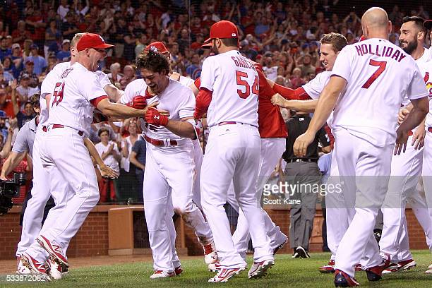 Randal Grichuk of the St Louis Cardinals is mobbed by teammates as they celebrate his solo walkoff home run during the ninth inning of a baseball...