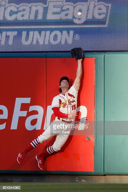 Randal Grichuk of the St Louis Cardinals is unable to catch a tworun home run ball hit by Paul Goldschmidt of the Arizona Diamondbacks during the...