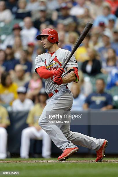 Randal Grichuk of the St Louis Cardinals makes some contact at the plate during the game against the Milwaukee Brewers at Miller Park on August 08...