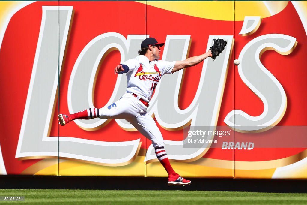 Randal Grichuk #15 of the St. Louis Cardinals misplays a line drive against the Arizona Diamondbacks in the seventh inning at Busch Stadium on July 30, 2017 in St. Louis, Missouri.