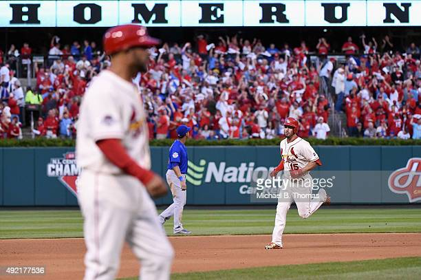 Randal Grichuk of the St Louis Cardinals runs the bases after hitting a solo home run in the fifth inning against the Chicago Cubs during game two of...