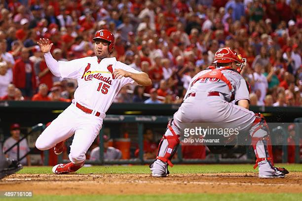 Randal Grichuk of the St Louis Cardinals scores a run against the Cincinnati Reds in the sixth inning at Busch Stadium on September 23 2015 in St...