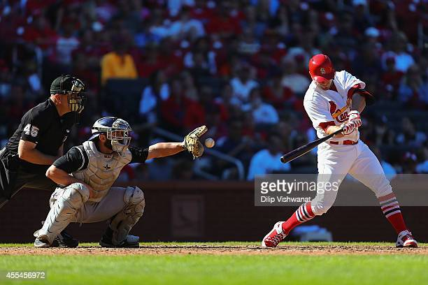 Randal Grichuk of the St Louis Cardinals strikes out against Michael McKenry of the Colorado Rockies in the seventh inning at Busch Stadium on...