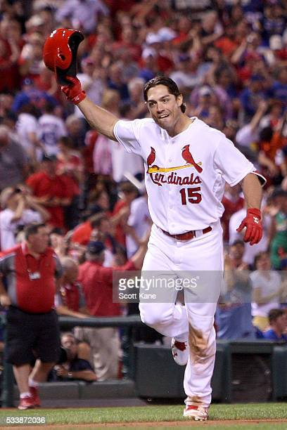 Randal Grichuk of the St Louis Cardinals waves hit helmet as he approaches home plate after hitting a solo walkoff home run during the ninth inning...