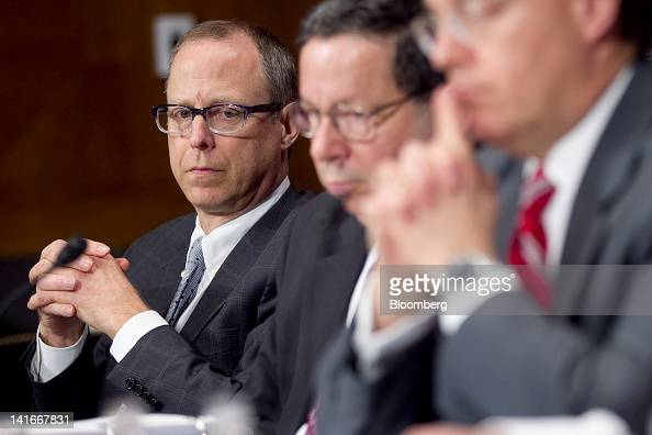 Randal Milch executive vice president and general counsel with Verizon Communications Inc left to right David Cohen executive vice president of...