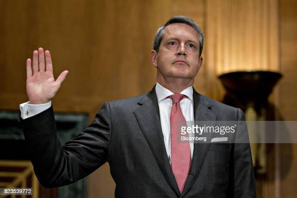 Randal Quarles governor of the US Federal Reserve nominee for US President Donald Trump swears in to a Senate Banking Committee nomination hearing in...