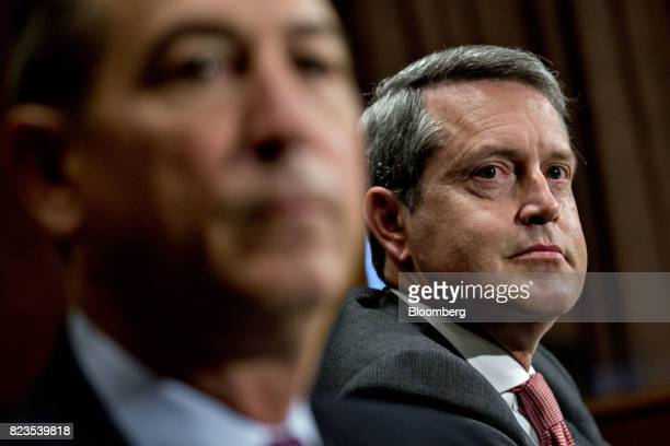 Randal Quarles governor of the US Federal Reserve nominee for US President Donald Trump listens during a Senate Banking Committee nomination hearing...