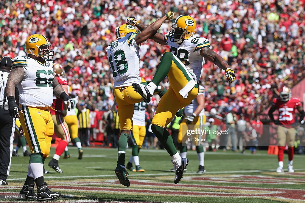 Randall Cobb #18 and <a gi-track='captionPersonalityLinkClicked' href=/galleries/search?phrase=Jermichael+Finley&family=editorial&specificpeople=3047554 ng-click='$event.stopPropagation()'>Jermichael Finley</a> #88 of the Green Bay Packers celebrate a touchdown in the first quarter during an NFL game against San Francisco 49ers at Candlestick Park on September 8, 2013 in San Francisco, California.