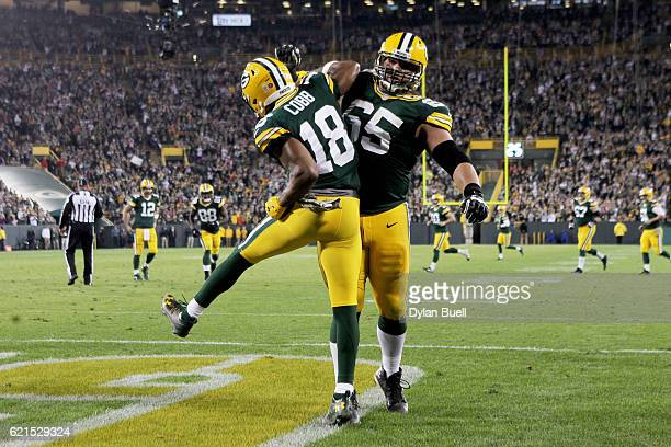 Randall Cobb and Lane Taylor of the Green Bay Packers celebrate after Cobb scored a touchdown in the fourth quarter against the Indianapolis Colts at...