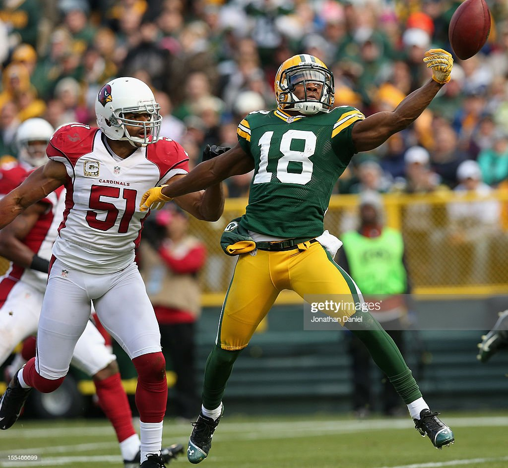 Randall Cobb #18 of the Green Bay Packers can't reach a pass as <a gi-track='captionPersonalityLinkClicked' href=/galleries/search?phrase=Paris+Lenon&family=editorial&specificpeople=2111080 ng-click='$event.stopPropagation()'>Paris Lenon</a> #51 of the Arizona Cardinals defends at Lambeau Field on November 4, 2012 in Green Bay, Wisconsin.
