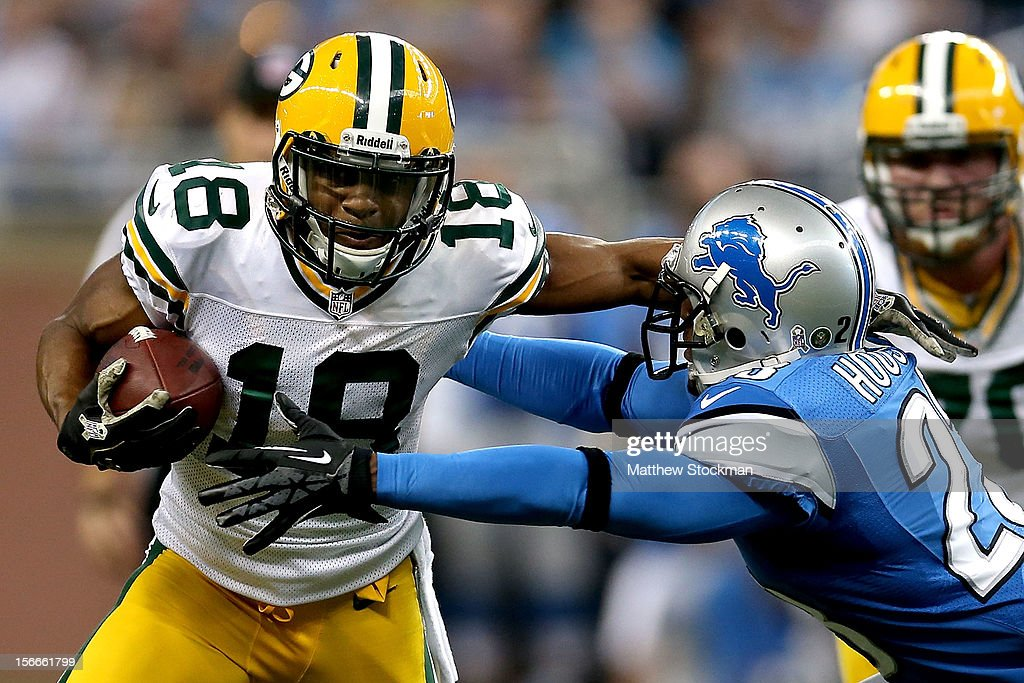 Randall Cobb #18 of the Green Bay Packers carries the ball against Chris Houston #23 of the Detroit Lions at Ford Field on November 18, 2012 in Detroit, Michigan.