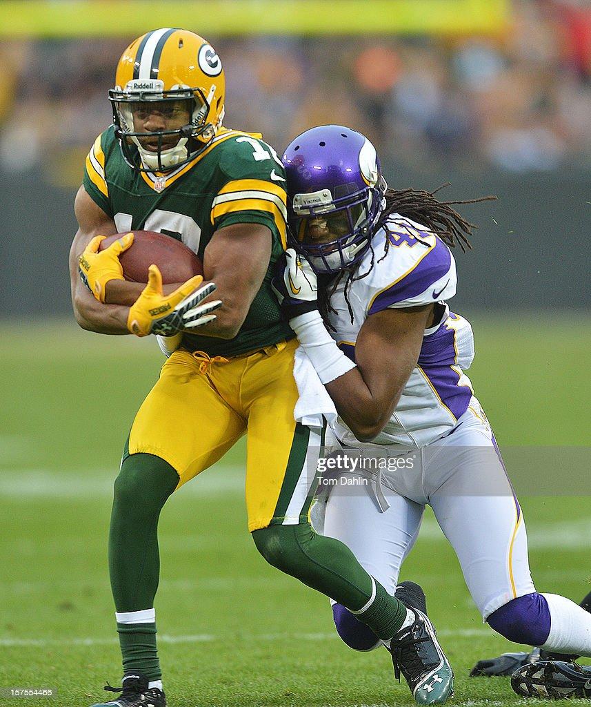 Randall Cobb #18 of the Green Bay Packers carries the ball against Mistral Raymond #41 of the Minnesota Vikings during an NFL game at Lambeau Field on December 2, 2012 in Green Bay, Wisconsin.