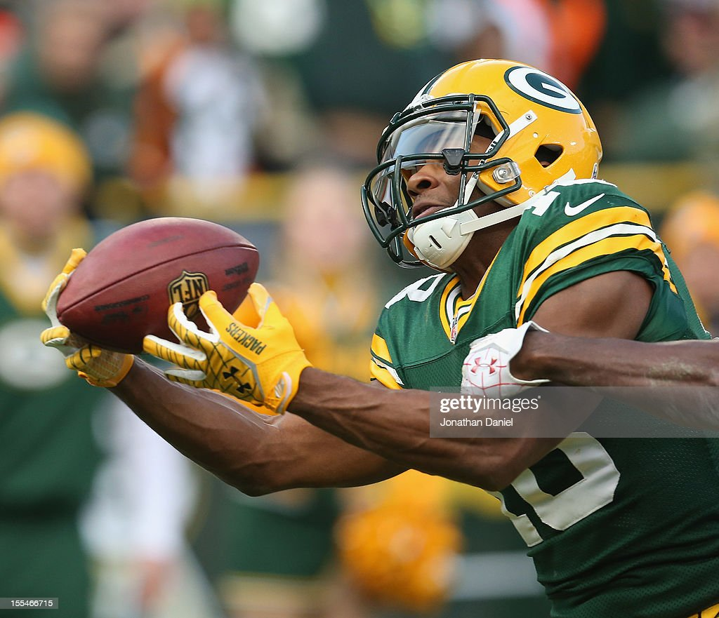 Randall Cobb #18 of the Green Bay Packers catches a touchdown pass against the Arizona Cardinals at Lambeau Field on November 4, 2012 in Green Bay, Wisconsin.