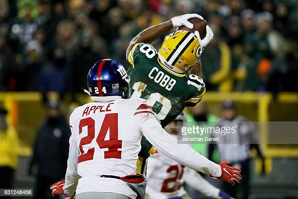 Randall Cobb of the Green Bay Packers catches a touchdown pass while being guarded by Eli Apple of the New York Giants in the fourth quarter during...