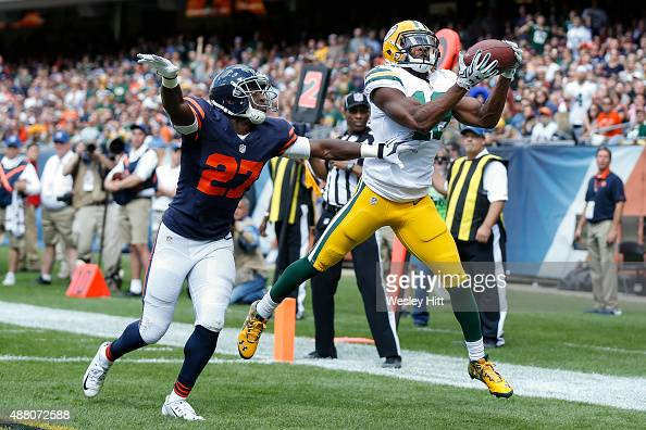 Randall Cobb of the Green Bay Packers receives a 5 yard pass against Sherrick McManis of the Chicago Bears for a touchdown in the fourth quarter at...