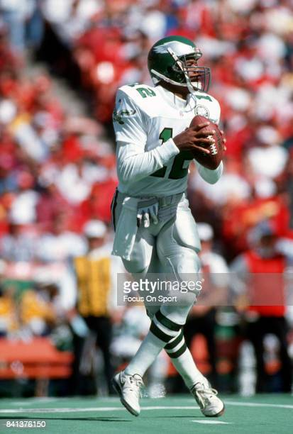 Randall Cunningham of the Philadelphia Eagles drops back to pass against the Kansas City Chiefs during an NFL Football game October 11 1992 at...
