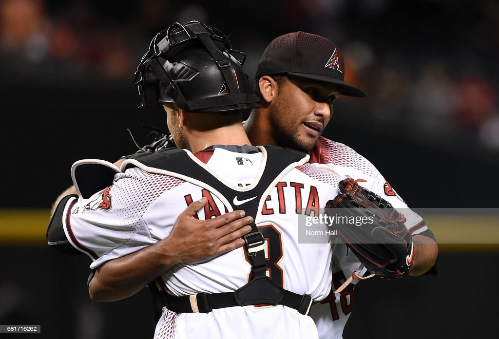 Randall Delgado #48 and Chris Iannetta #8 of the Arizona Diamondbacks celebrate a 7-1 win against the Detroit Tigers at Chase Field on May 10, 2017 in Phoenix, Arizona.