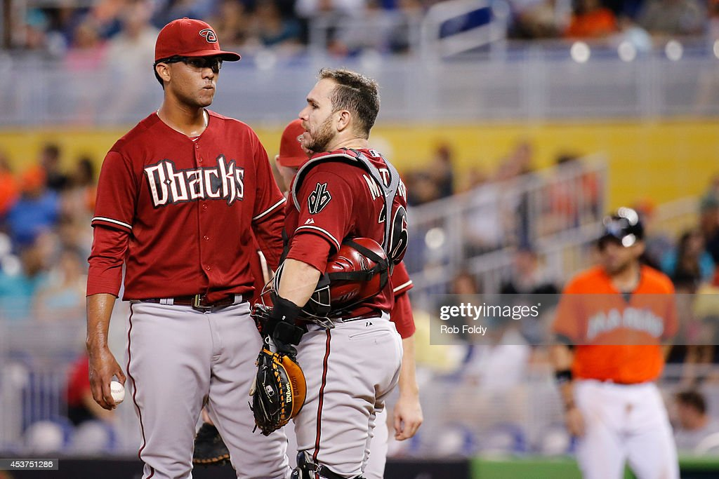 Randall Delgado #48 of the Arizona Diamondbacks meets with <a gi-track='captionPersonalityLinkClicked' href=/galleries/search?phrase=Miguel+Montero&family=editorial&specificpeople=836495 ng-click='$event.stopPropagation()'>Miguel Montero</a> #26 during the seventh inning of the game against the Miami Marlins at Marlins Park on August 17, 2014 in Miami, Florida.