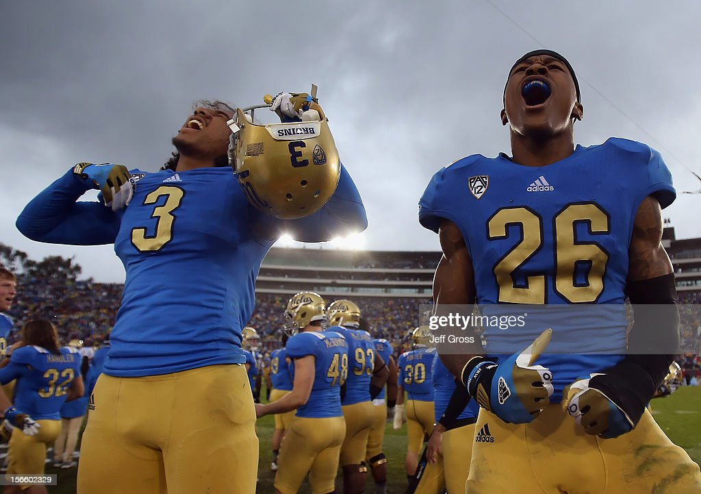 Randall Goforth #3 and Andrew Abbott #26 of the UCLA Bruins celebrate their teams 38-28 victory over the USC Trojans at the Rose Bowl on November 17, 2012 in Pasadena, California.