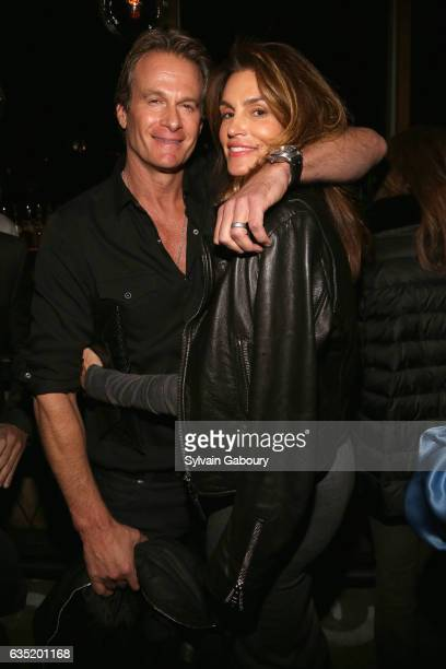 Rande Gerber and Cindy Crawford attend 20th Century Fox and Prada Host the After Party for 'A Cure for Wellness' at Mr Purple at the Hotel Indigo LES...
