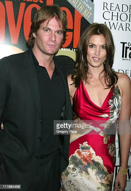 Rande Gerber and Cindy Crawford wearing a Roberto Cavalli dress